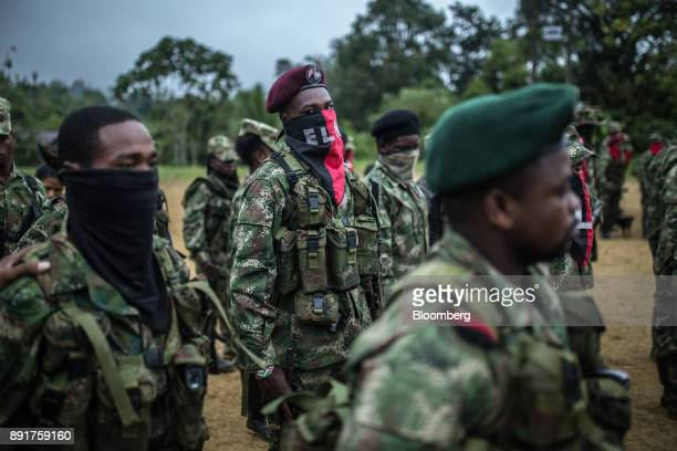 National Liberation Army guerrillas stand in formation during a meeting in a remote village in Choco Department Colombia on Friday Nov 17 2017 The...