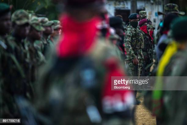 National Liberation Army guerrillas stand in formation during a meeting in a remote village in Choco Department Colombia on Saturday Nov 18 2017 The...