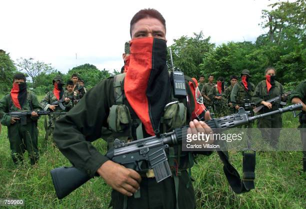 National Liberation Army soldiers stand in formation at one of their camps near the front line April 11 2002 in the Arauca province of Colombia The...