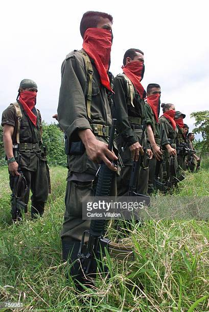National Liberation Army soldiers stand in formation at one of their camps near the front line April 11, 2002 in the Arauca province of Colombia. The...
