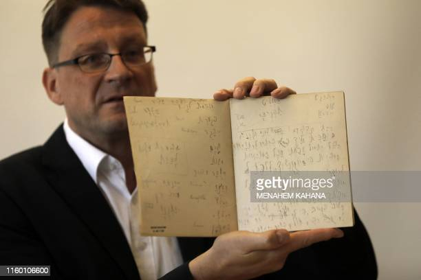 National Library archival expert and Humanities Collection Curator Stefan Litt reveals manuscripts by novelist Franz Kafka, during a press conference...