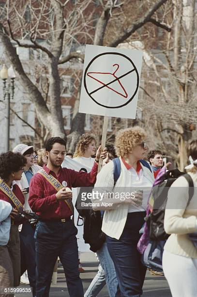 A National March for Women's Lives in Washington DC 9th March 1986 One prochoice protestor holds an image of a coat hanger with a cross through it