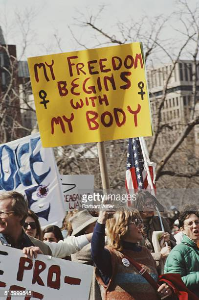 A National March for Women's Lives in Washington DC 9th March 1986 One prochoice protestor holds a placard reading 'My freedom begins with my body'
