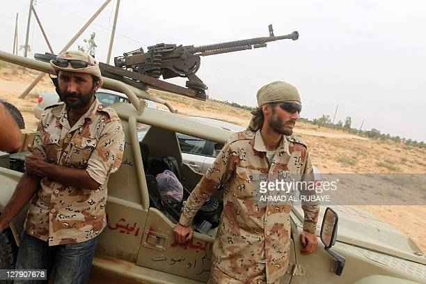 DESHMUKH US national Matthew VanDyke is seen at the eastern front to the city Sirte on October 2 2011 VanDyke from Baltimore was held by Moamer...