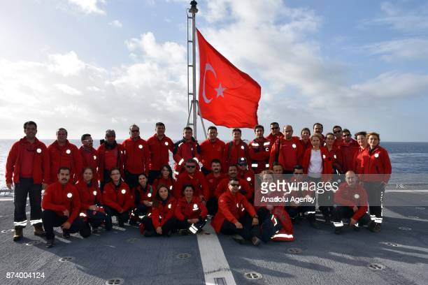 National Medical Rescue Team crew pose for a family photo on TCG Bayraktar navy vessel during Eastern Mediterranean Naval Exercise at eastern...