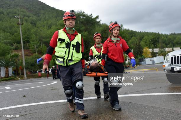 National Medical Rescue Team members carry a person pretended to be a survivor of a disaster with a stretcher as part of the eastern Mediterranean...