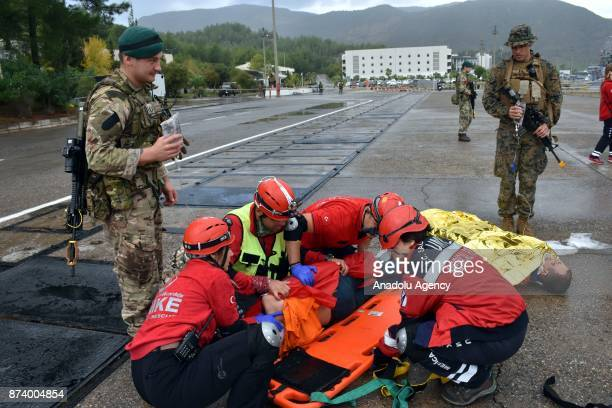 National Medical Rescue Team members perform as first responders to a person pretended to be a survivor of a disaster as part of the eastern...