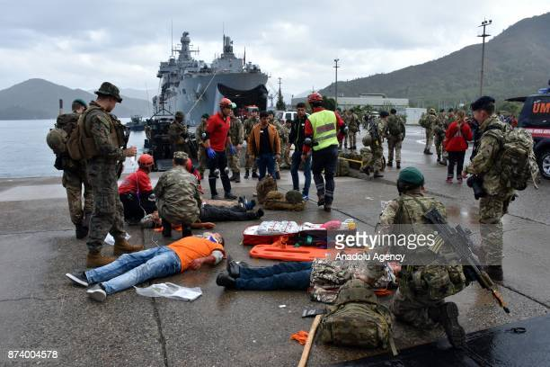 National Medical Rescue Team members perform as first responders to people pretended to be the survivors of a disaster as part of the eastern...