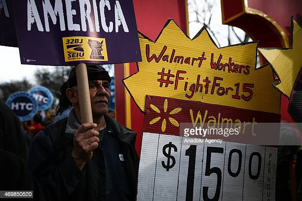 A national movement 'Fight For $15' including workers and labor unions march to raise the minimum wage to $15/hour at Colombus Square in New York...