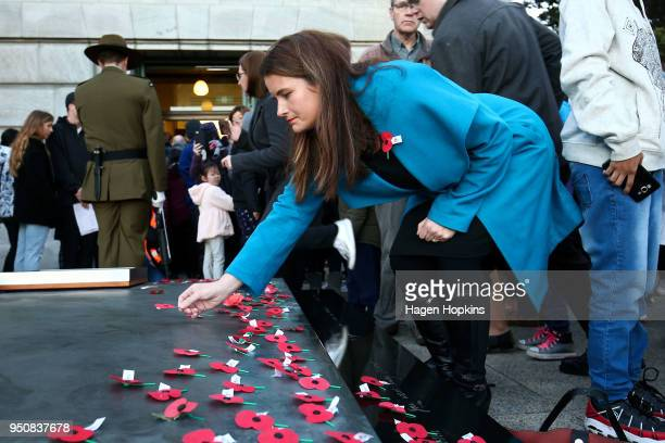 National MP Nicola Willis lays a poppy on the Tomb of the Unknown Warrior during the Anzac Day Dawn Service at Pukeahu National War Memorial Park on...