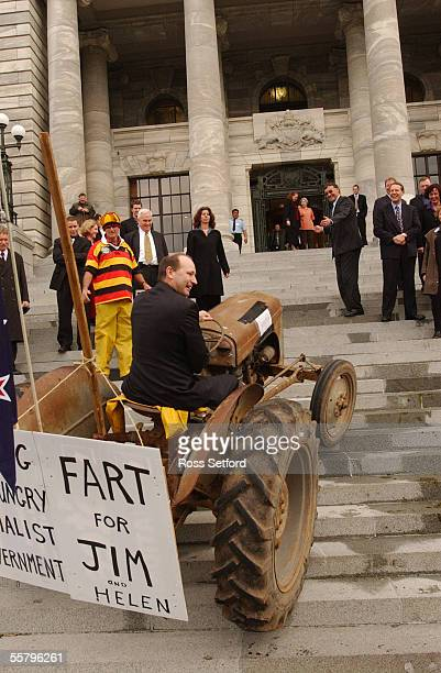 National MP Shane Ardern attempts to drive a tractor up the stairs of Parliament Thursday during a protest by farmers against the so called fart tax...
