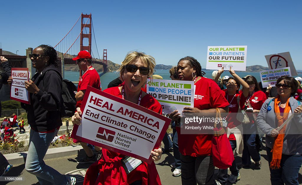 National Nurses United members and environmental activists protest against the Keystone XL pipeline will marching over the Golden Gate Bridge on June 20, 2013 in San Francisco, California. More than a thousand people protested against the pipeline construction and called on the Obama administration to reject the proposal.