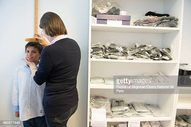 National Opera Ballet School pupil has his height measured during the first day of the new school term on September 3 2012 in Nanterre France The...