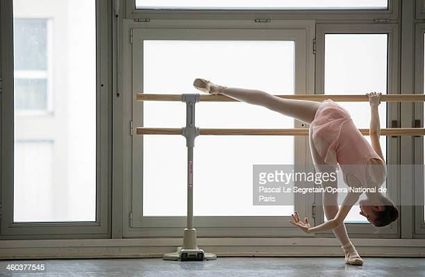 National Opera Ballet School student practices at the bar during a dance lesson at the National Opera Ballet School on February 20 2013 in Nanterre...