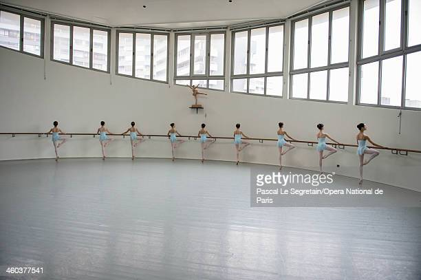 National Opera Ballet School students practice at the bar during a dance lesson on September 20 2012 in Nanterre France The oldest ballet school of...