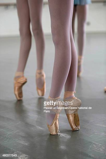 National Opera Ballet School students practice en pointe during a dance lesson at the National Opera Ballet School on February 27 2013 in Nanterre...