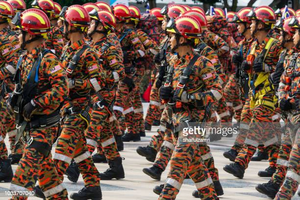 national parade from multi division and agencies takes part during the 61st independence day celebration held at the administrative capital of putrajaya. - shaifulzamri stock-fotos und bilder