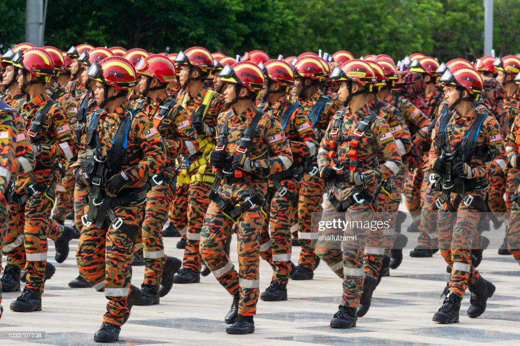 National parade from multi division and agencies takes part during the 61st Independence Day celebration held at the administrative capital of Putrajaya. : Stock Photo