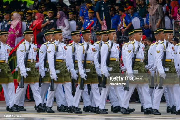 national parade from multi people and agencies takes part during the 61st independence day celebration held at the administrative capital of putrajaya. - shaifulzamri stock pictures, royalty-free photos & images