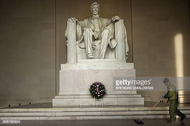National Park employee cleans the floor of the Lincoln Memorial after a wreathlaying ceremony to honor Abraham Lincoln's 207th birthday February 12...