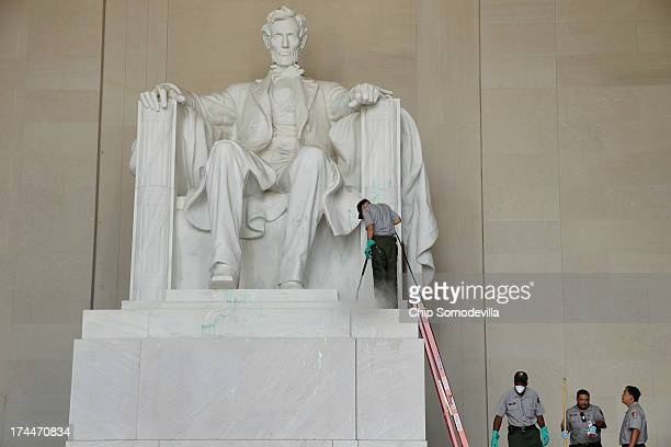 S National Park Service employees use a pressure washer to clean the Lincoln Memorial after it was vandalized with a splatter of green paint July 26...