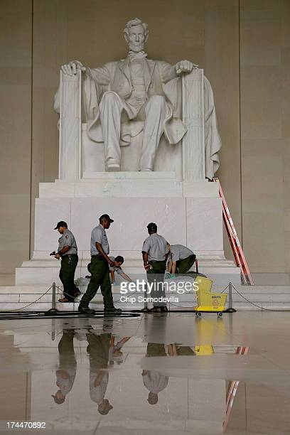 S National Park Service employees use a variety of tools including razor blades plastic paint scrapers sponges solvents and a pressure washer to...
