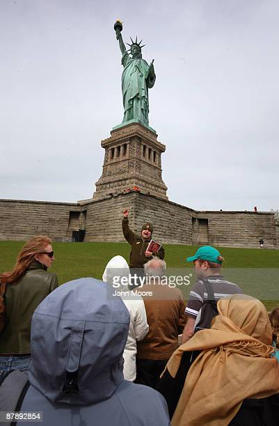 National Park Service guide speaks to a tour group set on Liberty Island in the New York Harbor on May 18 2009 in New York City Enhanced security...