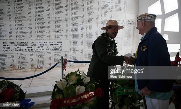 National Park Service Historian Daniel Martinez greets U.S.S. Arizona Survivor Lou Conter after a memorial service for the 70th anniversary of the...