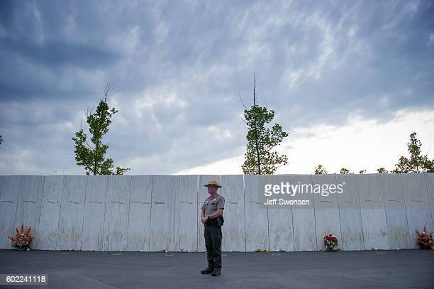 National Park Service ranger waits before the start of a luminaria service at the Flight 93 National Memorial on September 10 2016 in Shanksville...