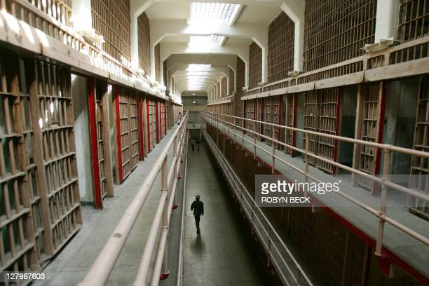 A National Park Service ranger walks down Broadway in the main cell block on Alcatraz Island 14 June 2007 in San Francisco Bay of California...