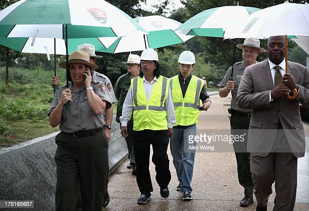 National Park Service spokesperson Carol Johnson Superintendent of the National Mall and Memorial Parks Bob Vogel Sculptor Lei Yixin his son and...