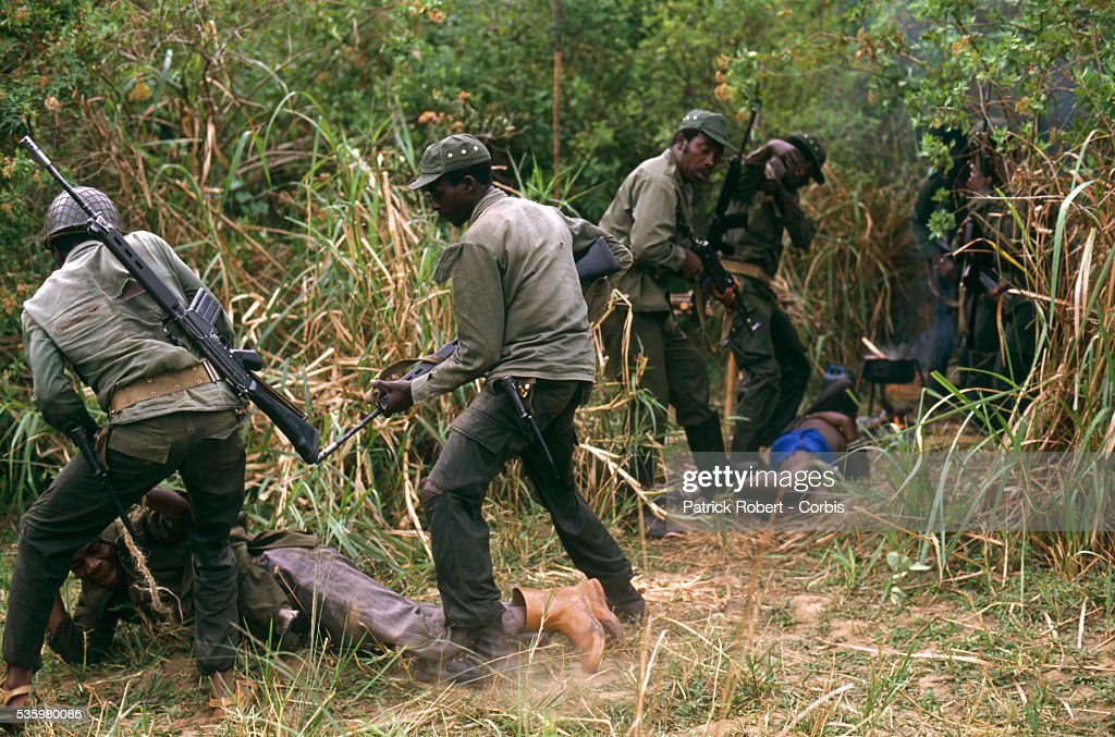 National Parks Guards arrest a group of poachers in Zaire. The national parks continue to struggle against the poaching of elephants and the traffic of ivory in Zaire (now the Democratic Republic of Congo).
