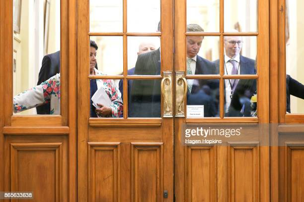 National Party leader Bill English and deputy leader Paula Bennett get stuck behind a security door on their way to a post caucus press conference at...