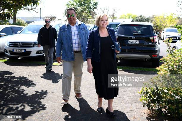 National Party leader Judith Collins and husband David Wong Tung arrive to vote at St Thomas Church on October 04, 2020 in Auckland, New Zealand. The...