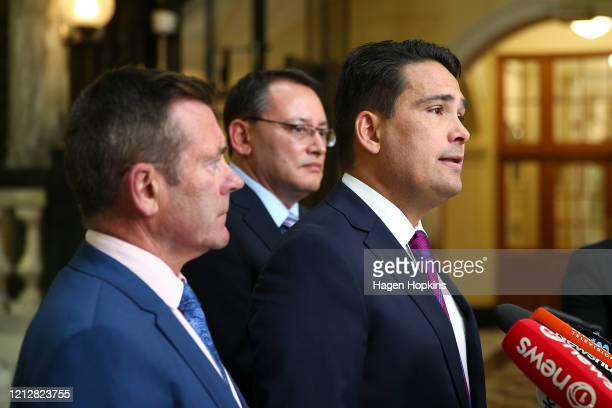 National party leader Simon Bridges speaks while MPs Michael Woodhouse and Dr Shane Reti look on during a press conference at Parliament on March 17...