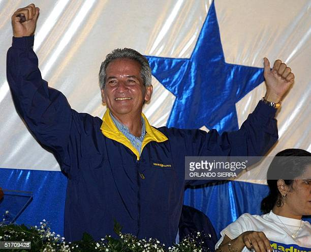 National Party of Honduras presidential candidate Ricardo Maduro greets supporters 25 November gathered at the party headquarters in Tegucigalpa...