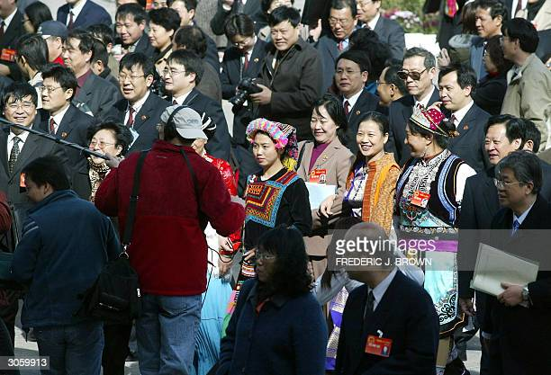 National People's Congress delegates attend a session at the Great Hall of the People 10 March 2004 in Beijing China is considering rescinding the...