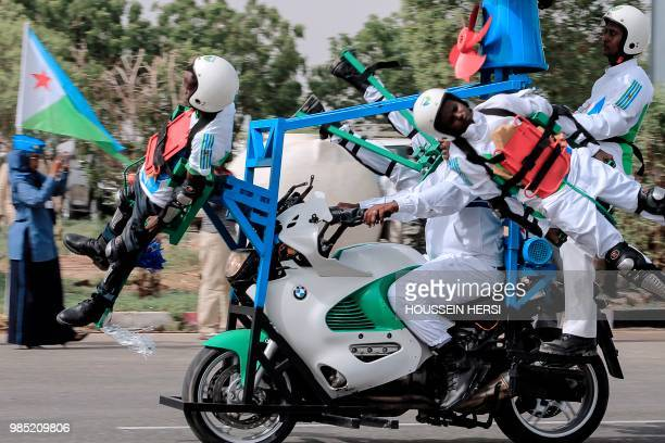 National police forces perform acrobatic skills during a parade marking the 41st anniversary of Djibouti's independence in Djibouti on June 27 2018