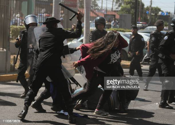 """National police officers repress opposition member Valeska Valle , and other demonstrators, taking part in a """"National sit-in"""" protest against..."""