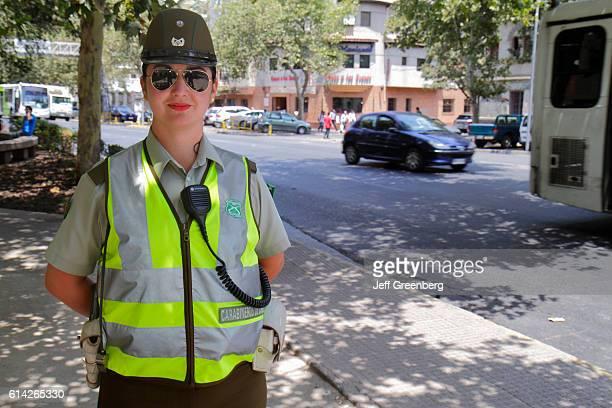 National police woman wearing reflective vest Avenida Vicuna Mackenna