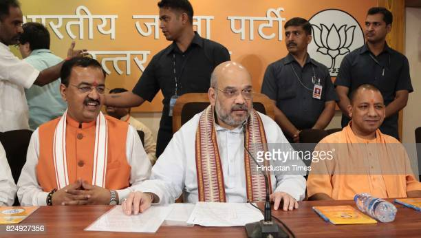 National President Amit Shah along with UP Chief Minister Yogi Adityanath and Deputy CM Keshav Prashad Maurya holds a press conference at BJP office...