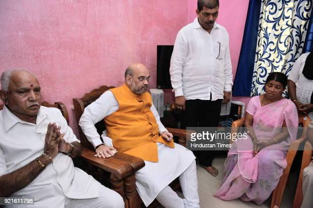 BJP national president Amit Shah and BJP Karnataka state president and party chief ministerial candidate Yeddyurappa meet the family members of...