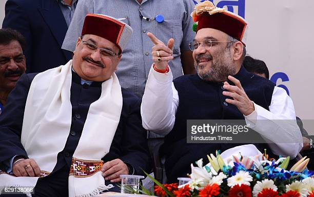 National President Amit Shah and Union Health Minister JP Nadda during the Tridev Sammelan at Thodo Ground on December 11 2016 in Solan India...
