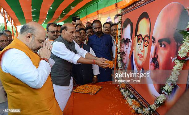 National President Amit Shah and Union Home Minister Rajnath Singh paying floral tributes to the Portraits of Pandit DeenDayal Upadhyaya Bhimrao...