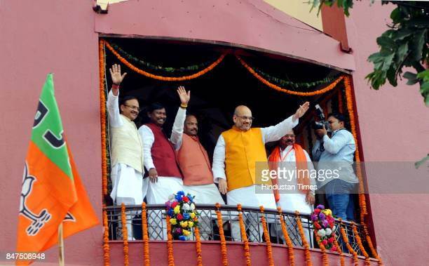 National President Amit Shah Chief Minister Raghubar Das former Chief Minister Arjun Munda wave to party workers after paying tribute on bust of...