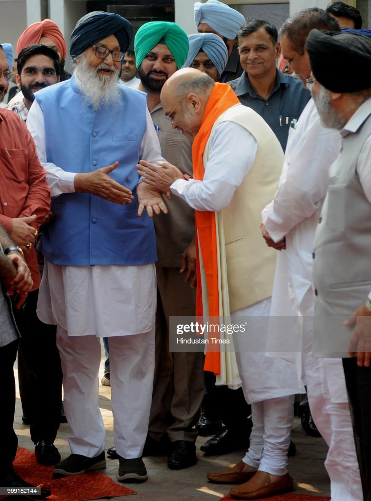 National President Amit Shah greets former Chief Minister Parkash Singh Badal as other leaders look on at MLA Hostel in Sector 3 on June 7 2018 in...