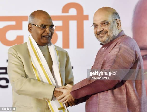 National President Amit Shah greets newly elected President of India Ram Nath Kovind after his win in Presidential election at 10 Akbar Road on July...