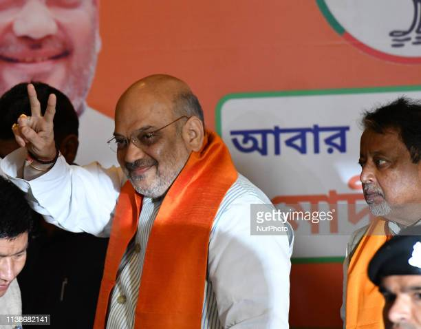 BJP National President Amit Shah showing victory Singh along Mukul Roy at the Meet the Press on April 222019 in KolkataIndia