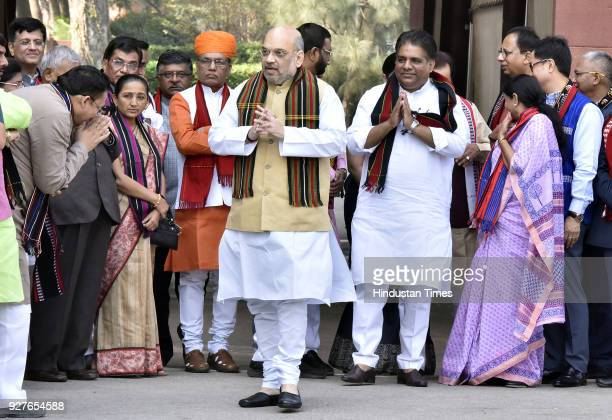 National President Amit Shah talking with cabinet ministers and other BJP MPs as they welcome Prime Minister Narendra Modi after their victory in the...