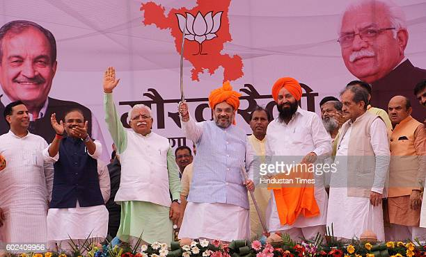 National President Amit Shah Union Minister Birender Singh Haryana Chief Minister Manohar Lal Khattar and Agriculture Minister OP Dhankar during a...